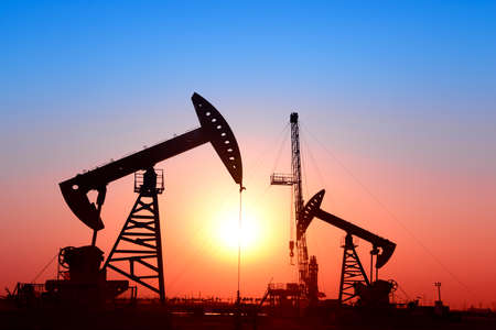 pumping unit: pumping unit, sunset in oil field Stock Photo