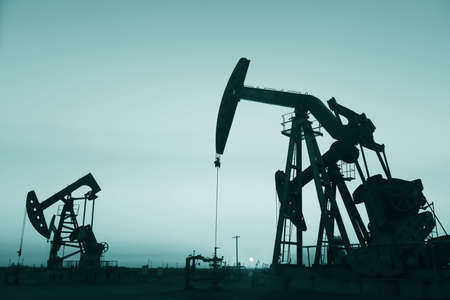 oil field: Pumpjack in oil field Stock Photo