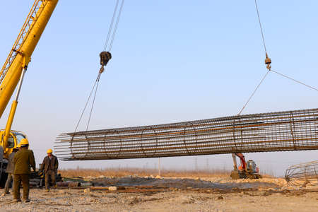 erecting: Hoisting steel bars in the construction site