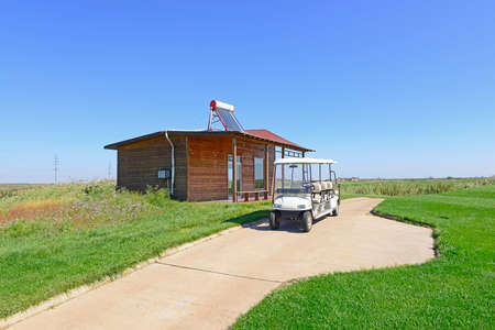 travel features: Golf cart in a golf course