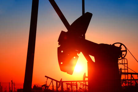 oilwell: Pumping unit is working, under the sunset