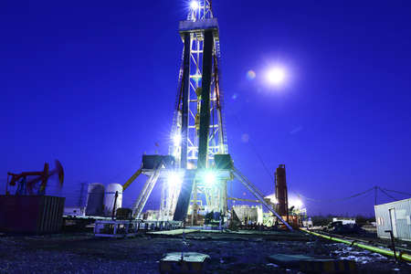 oil derrick in work, on the night of oilfield