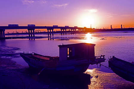 The fishing boat on river in the evening Stock Photo