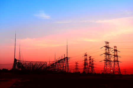 High piezoelectric towers, in the setting sun  Stock Photo