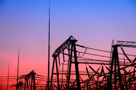 High voltage substation, in the setting sun Stock Photo