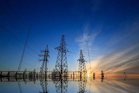 A high voltage substation under sunrise Reklamní fotografie
