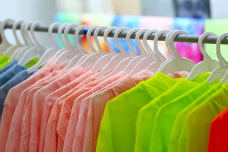 Clothes hang on hangers Stock Photo