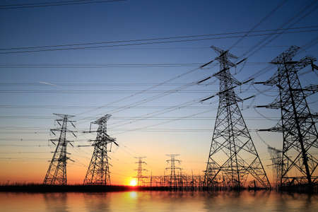 high-voltage tower in the setting sun against the sky Imagens