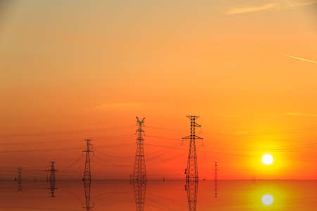 High piezoelectric towers, in the setting sun