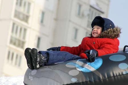 The boy, going for a drive in the winter on tubing
