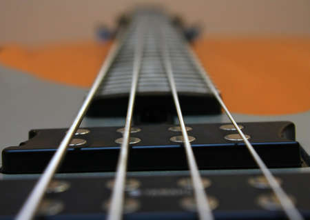 Silvery strings on a bass guitar  Stock Photo