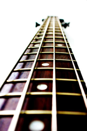 Neck of a bass guitar with silver strings