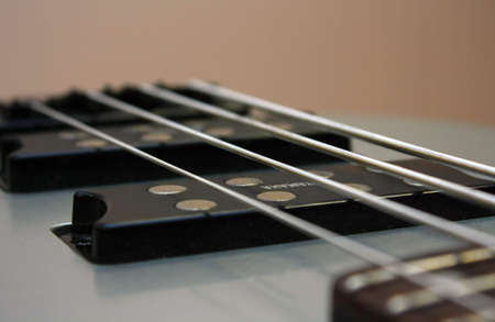 Silvery strings on a bass guitar