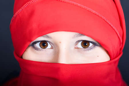 East woman in a red scarf photo
