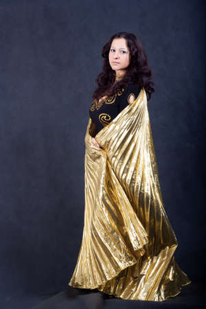 Asian women with gold wings in studio photo
