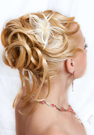 Hairdress of the girl with ornaments