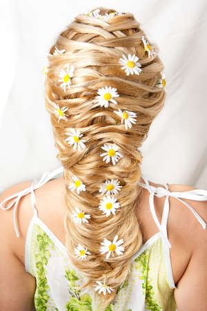 Flower hairdress of the girl on a white background