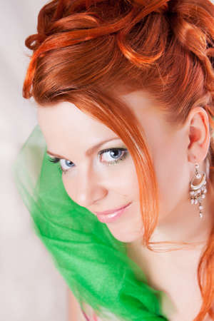 Portrait of the red haired girl with a penetrating glance photo
