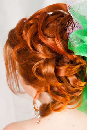Hairdress of the girl with red hair Stock Photo