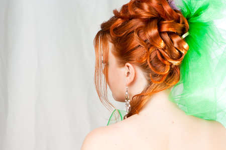 Hairdress of the girl behind with red hair
