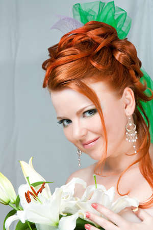 Furtive look of the beautiful girl with red hair Stock Photo