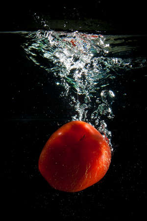 Sweet pepper in water with vials in falling