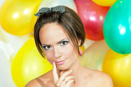 Portrait of the girl with inflatable balls against Stock Photo