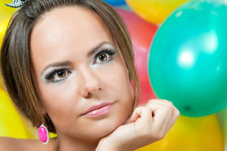 Close up a portrait, against multi-coloured balloons Stock Photo
