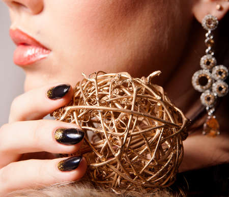 Glamour portrait, sphere in a hand and lips photo