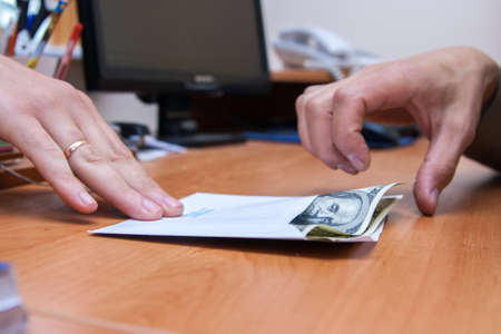 envelope with the money is transferred as a bribe Stock Photo