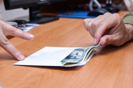 The transfer of an envelope with a bribe Stock Photo - 14177278
