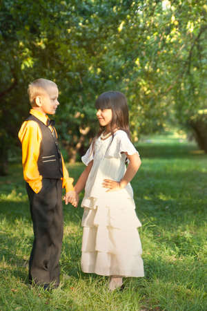 Portrait of a little boy and girl in beautiful dress photo