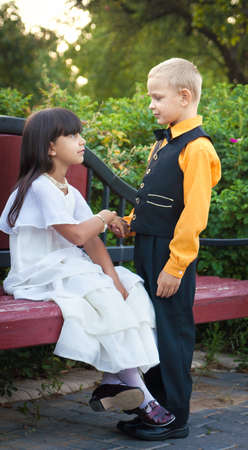 little boy and girl in beautiful dress photo