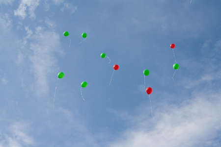 Red and green balloons in the sky