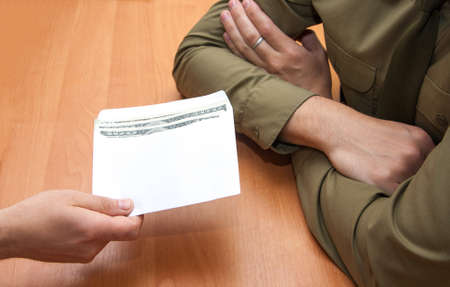 Bribes in a white envelope on the table in the office Stock Photo