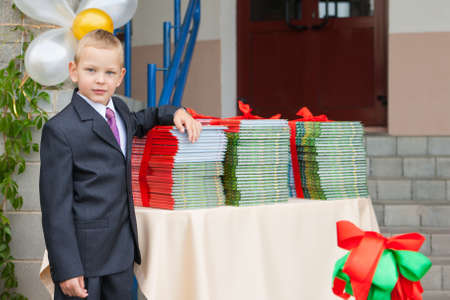 Schoolboy in a suit for the first day of school Stock Photo - 15759352