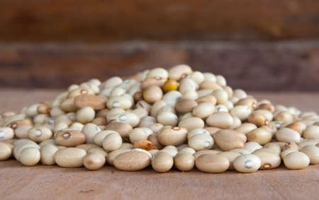 Hill of beans on a wooden table with wood background photo