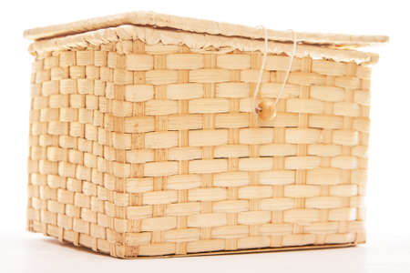 Wicker box with zip isolated on white Stock Photo