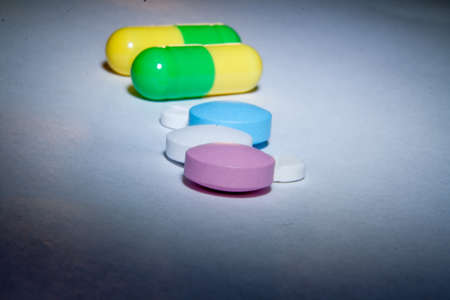 Colored pills on paper macro