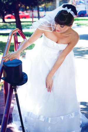 The bride brunette stares at the hat-cylinder Stock Photo