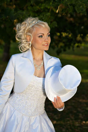 Hat-cylinder in the hands of the bride