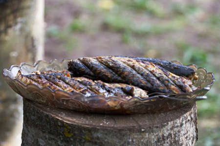 fried mackerel on the grill outdoors