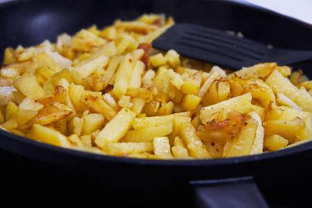 Juicy fried potatoes fried in a pan photo
