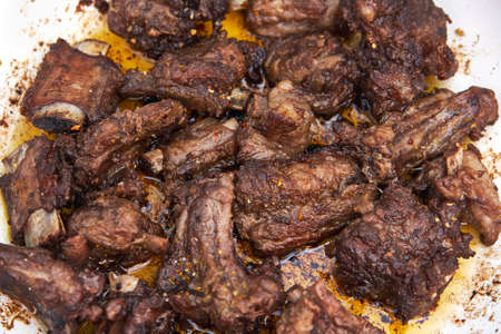 Grilled meat ribs on the pan Stock Photo