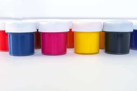 four color printing: The many colored paint bucket CMYK Stock Photo