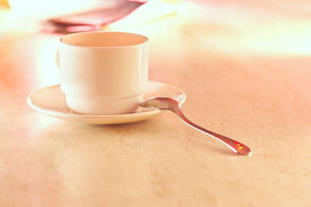 Coffee cup in light on table Stock Photo