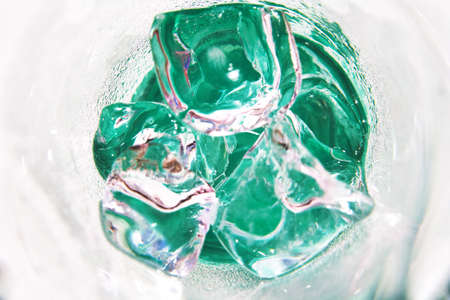 Background of ice cubes in glass