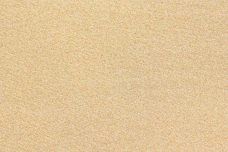 Background fine sand on top of a light-brown Stock Photo
