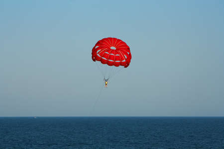 Parachuting at sea, Parasailing with a boat over the sea