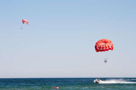 Parachuting at sea, Parasailing with a boat over the sea